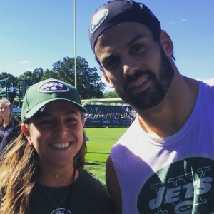 Eric Decker poses with Danielle McCartan (@CoachMcCartan) after practice at the New York Jets inaugural Anti-Bullying symposium in Florham Park, NJ.