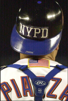 Photo courtesy of the New York Daily News. New York Mets catcher and Hall of Famer Mike Piazza dons an NYPD helmet on 9/21/11.