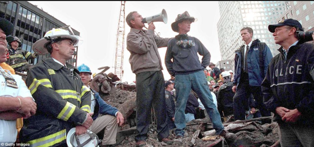 Former Presient George Bush gives a meaningful speech atop the rubble at Ground Zero in Manhattan. Police, firemen, first responders, and the entire world looked on.