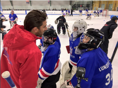Henrik Lundqvist, New York Rangers goaltender is surrounded by players at his recent Procamps at Chelsea Piers NYC