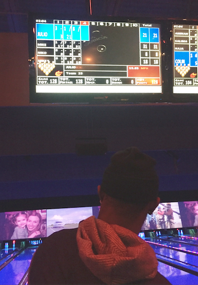 Credit: @CoachMcCartan Atlanta Falcons WR Julio Jones checks his score before taking the lane at Rally at the Alley.