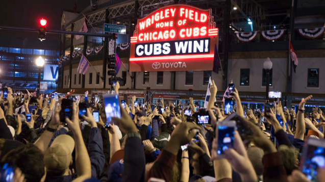Blue Collar Chicago Cubs raised 2016 world series banner at Wrigley Field among fans