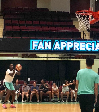 Liberty's Tina Charles drains a shot during warm ups on fan appreciation day at Westchester County Center.